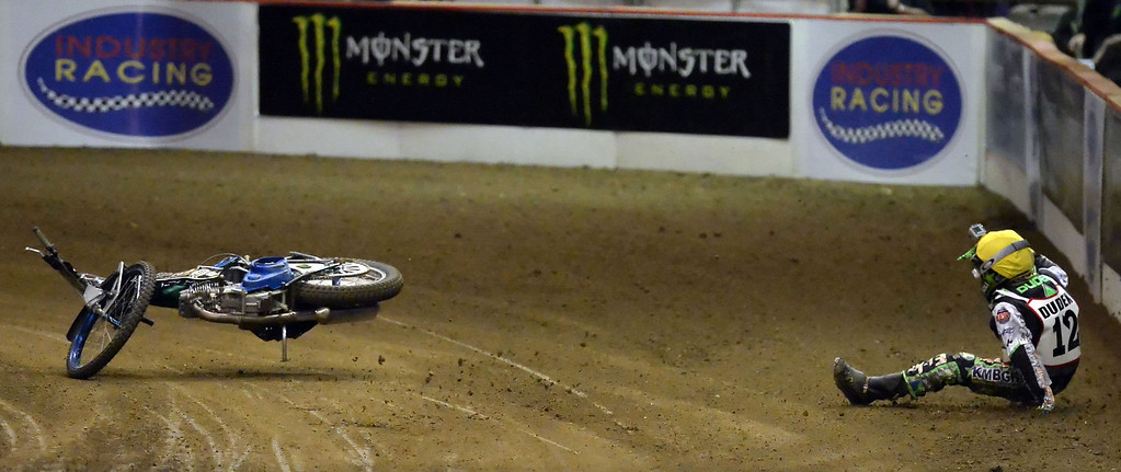 . Patryk Dudek (12) wrecks in the third race during the Monster Energy Speedway Cycles at the Industry Speedway in the Industry Hills Grand Arena in Industry, Calif., on Saturday, Dec. 28, 2013.     (Keith Birmingham Pasadena Star-News)