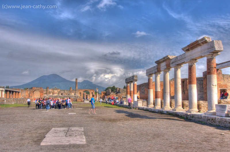 The un-earthed remains of Pompeii with Mount Vesuvius in the background.