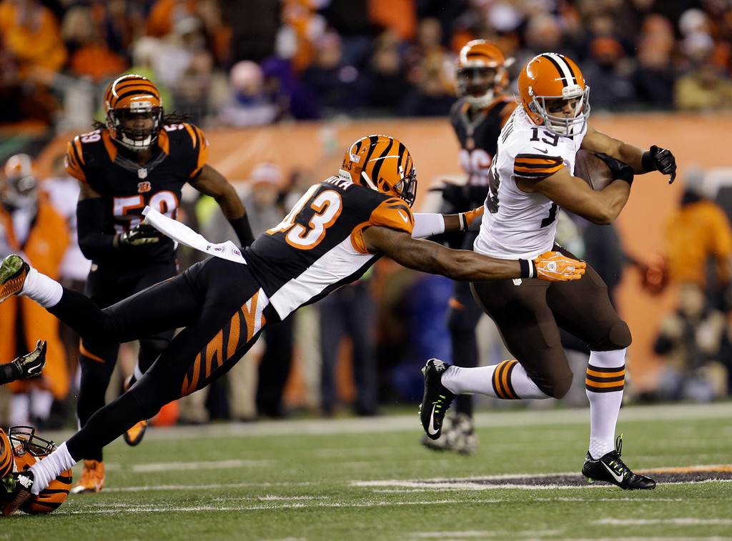 . Cleveland Browns wide receiver Miles Austin (19) runs past Cincinnati Bengals strong safety George Iloka (43) during the second half of an NFL football game Thursday, Nov. 6, 2014, in Cincinnati. (AP Photo/AJ Mast)