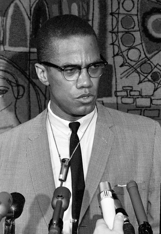 . Malcolm X addresses reporters at the Hotel Park-Sheraton in New York City on March 12, 1964.  (AP Photo)