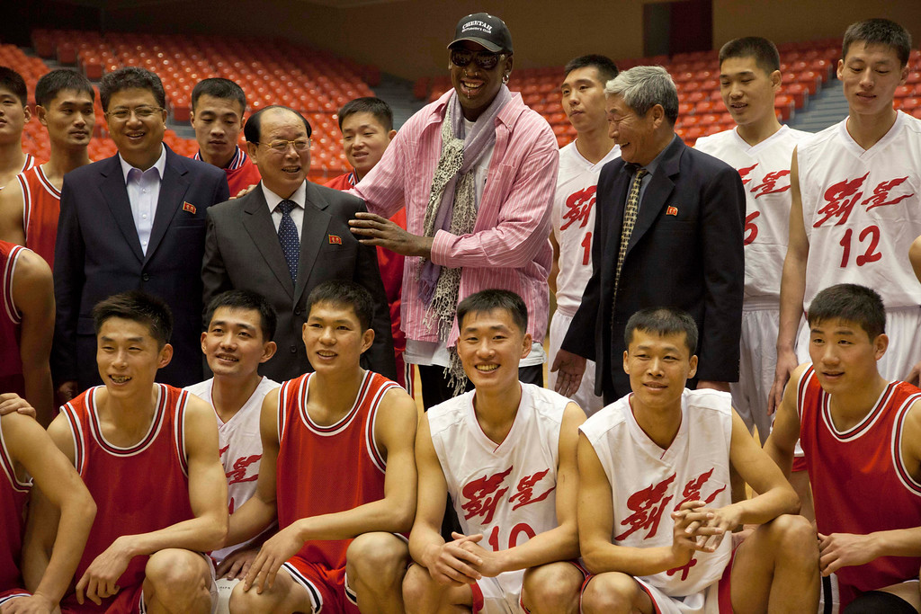. Former NBA basketball star Dennis Rodman poses for pictures with North Korean basketball players and government officials during a practice session in Pyongyang, North Korea on Friday, Dec. 20, 2013. Rodman selected the members of the North Korean team who will play in Pyongyang against visiting NBA stars on Jan. 8, 2014, the birthday of North Korean leader Kim Jong Un. (AP Photo/David Guttenfelder)