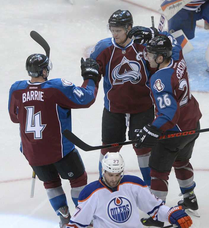 . DENVER, CO. - DECEMBER 19: Gabriel Landeskog and Paul Stastny congratulated Colorado defenseman Tyson Barrie after he got the Avs on the scoreboard in the second period. The Colorado Avalanche hosted the Edmonton Oilers in an NHL game at the Pepsi Center Thursday night, December 19, 2013.  Photo By Karl Gehring/The Denver Post