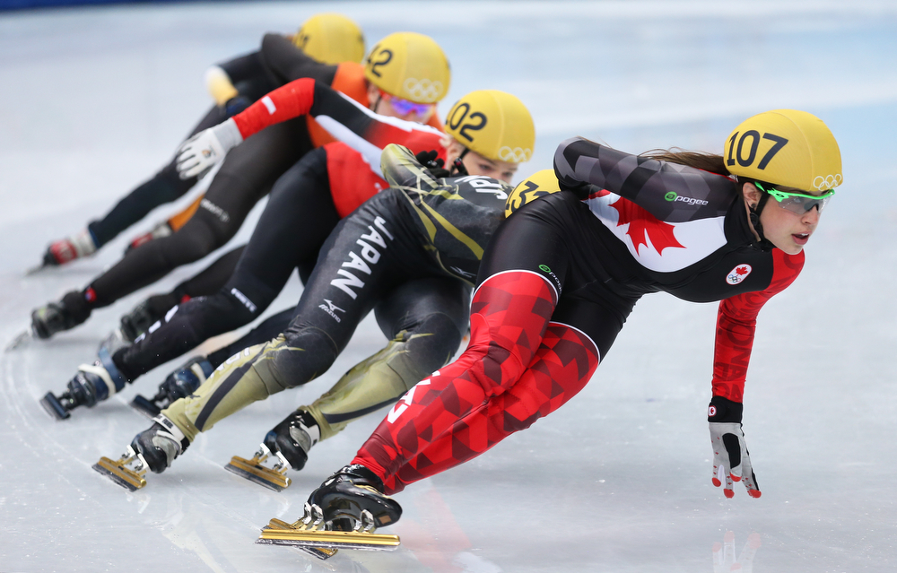 . Valerie Maltais of Canada leads the pack in the Short Track Women\'s 1000m Quarterfinals on day fourteen of the 2014 Sochi Winter Olympics at Iceberg Skating Palace on February 21, 2014 in Sochi, Russia.  (Photo by Matthew Stockman/Getty Images)