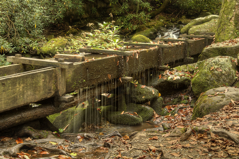 Water trickles out of a water duct alongside the Roaring Fork Motor Nature Trail in the Great Smoky Mountains National Park in Gatlinburg, TN on Sunday, September 28, 2014. Copyright 2014 Jason Barnette