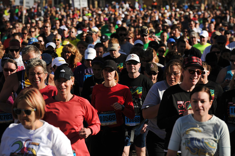 . The 31st annual Cherry Creek Sneak had all sorts of distances for this year\'s race.  The Sneak, as it is affectionately named, had a 10 mile, 5 mile, 3.1 mile or 5K, a 1.5 mile Denver\'s 7 Sprint, and a kid\'s fun run for thousands of competitors, runners and walkers that turned out in the Cherry Creek neighborhood of Denver, CO on April 28, 2013.  The race is always held the last Sunday in April. This year participants cheered the national anthem and observed a moment of silence for victims of the Boston Marathon bombing at the start of each race. (Photo by Helen H. Richardson/The Denver Post)