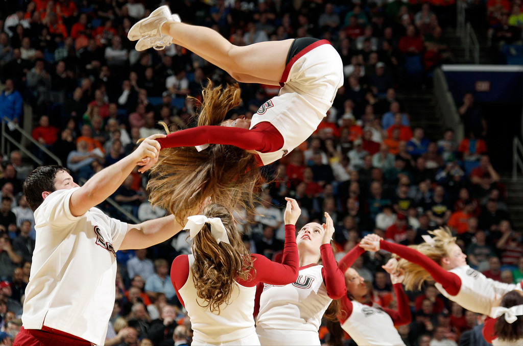 . Saint Joseph\'s cheerleaders perform during the second half of a second-round game in the NCAA college basketball tournament in Buffalo, N.Y., Thursday, March 20, 2014. Connecticut won 89-81. (AP Photo/Bill Wippert)