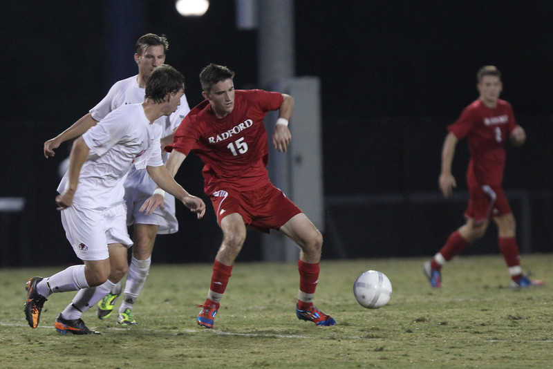 Riley Shelton (27) fights to get the ball back from Radford