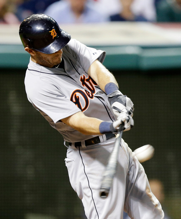 . Detroit Tigers\' Ian Kinsler hits an RBI-double off Cleveland Indians relief pitcher Carlos Carrasco in the ninth inning of a baseball game, Friday, June 20, 2014, in Cleveland. Rajai Davis scored. (AP Photo/Tony Dejak)