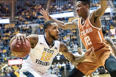 33142 Men's Basketball Action Texas February 2017