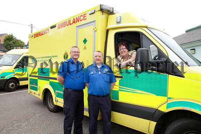 Shiela Quinn from Headway Newry and Mourne is pictured wih Raymond Lappin (EMT) and Trevor McGaffin (Paramadic) from the NI Ambulance Service who have undertaking a sponsored weight loss from June to october to raise much needed funds for the charity. R1426026
