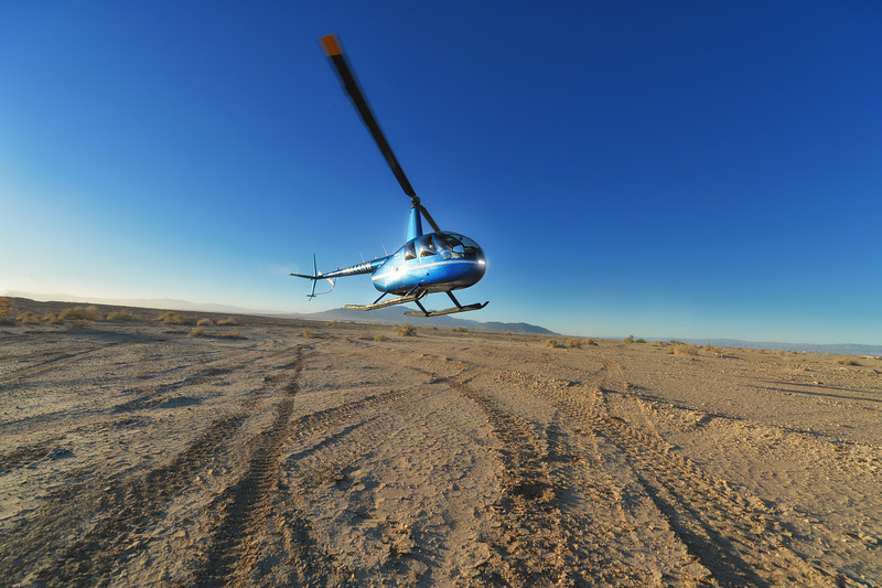 bill flying the helicopter to the desert