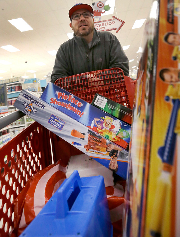 . Paul Poirier pushes his cart as he shops at Target on Black Friday, Nov. 25, 2016, in Wilmington, Mass. Stores open their doors Friday for what is still one of the busiest days of the year, even as the start of the holiday season edges ever earlier. (AP Photo/Elise Amendola)