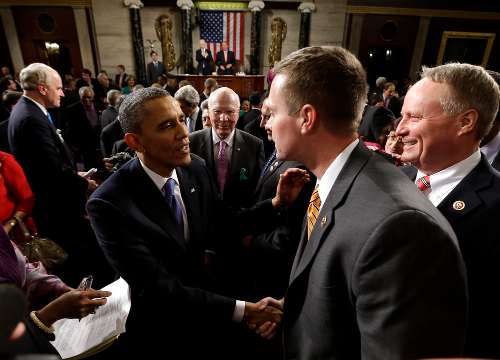 Description of . President Barack Obama shakes hands as he leaves after giving his State of the Union address during a joint session of Congress on Capitol Hill in Washington, Tuesday Feb. 12, 2013. (AP Photo/Charles Dharapak, Pool)