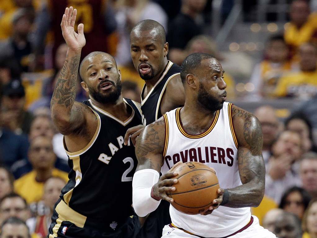 . Cleveland Cavaliers\' LeBron James, right, works against Toronto Raptors\' P.J. Tucker, left, and Serge Ibaka during the first half in Game 2 of a second-round NBA basketball playoff series, Wednesday, May 3, 2017, in Cleveland. (AP Photo/Tony Dejak)