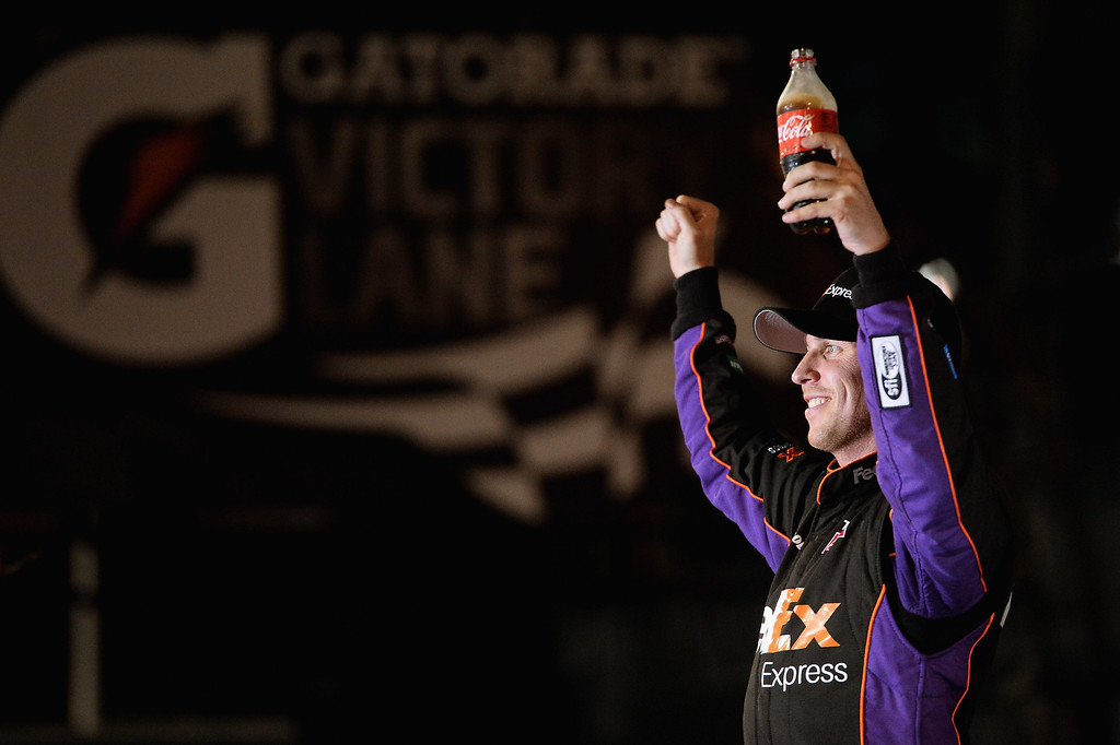 . Denny Hamlin, driver of the #11 FedEx Express Toyota, celebrates in Victory Lane after winning during the NASCAR Sprint Cup Series Budweiser Duel 2 at Daytona International Speedway on February 20, 2014 in Daytona Beach, Florida.  (Photo by Patrick Smith/Getty Images)