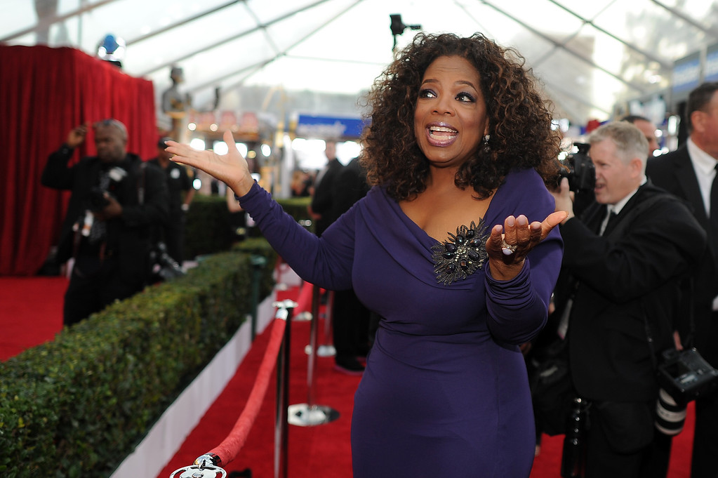 . Oprah Winfrey on the red carpet at the 20th Annual Screen Actors Guild Awards  at the Shrine Auditorium in Los Angeles, California on Saturday January 18, 2014 (Photo by Hans Gutknecht / Los Angeles Daily News)