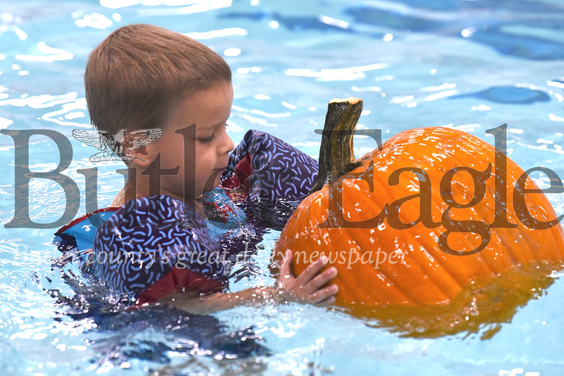 Grady Demitras, 4, swims with his pumpkin at the Butler YMCA's Floating Pumpkin Patch event Saturday. Seb Foltz/Butler Eagle