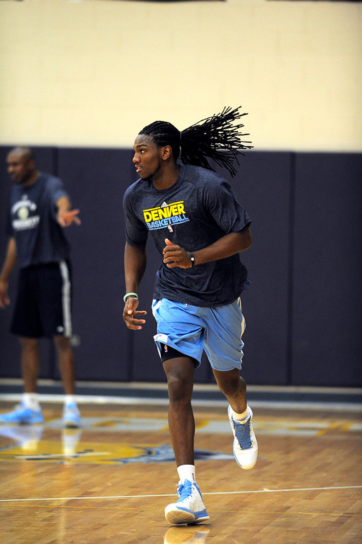 . Kenneth Faried (35) of the Denver Nuggets jogs during practice April 22, 2013 at Pepsi Center. The Denver Nuggets prepare for game two of the first round of the NBA playoffs against the Golden State Warriors. (Photo By John Leyba/The Denver Post)