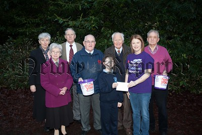 Jenay Doyle from NI Childrens Hospice accepts a cheque from members of the Bessbrook Development Company money raised through Carols Together. A hugh number gathered togetheralong with clergy representing Christ Church Bessbrook, St Peter and St Paul's Church, Bessbrook Methodist Church and the Salvation Army. R1604007