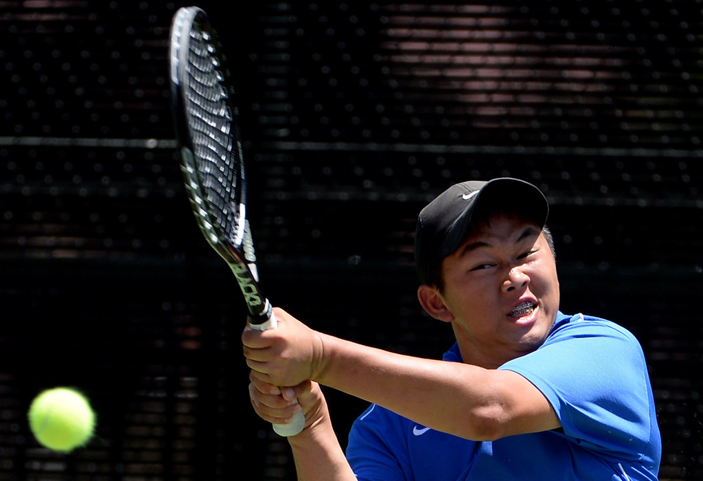 . San Marino\'s Timothy Doung returns a shot by University\'s (Irvine) Arash Hafezi (not pictured) during the CIF State Tennis Championship at the Claremont Club in Claremont, Calif., on Saturday, May 31, 2014. Hafezi 6-0, 6-1.   (Keith Birmingham/Pasadena Star-News)