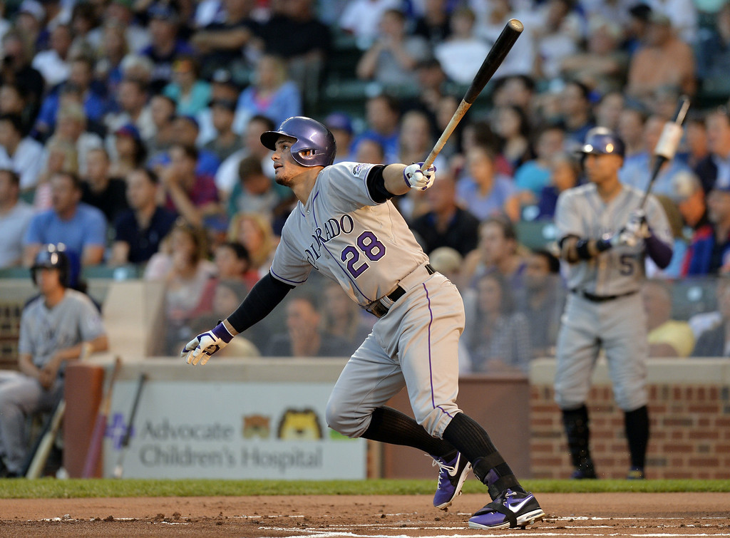 . Nolan Arenado #28 of the Colorado Rockies hits an RBI double, scoring teammate Corey Dickerson during the first inning against the Chicago Cubs on July 29, 2014 at Wrigley Field in Chicago, Illinois.  (Photo by Brian Kersey/Getty Images)