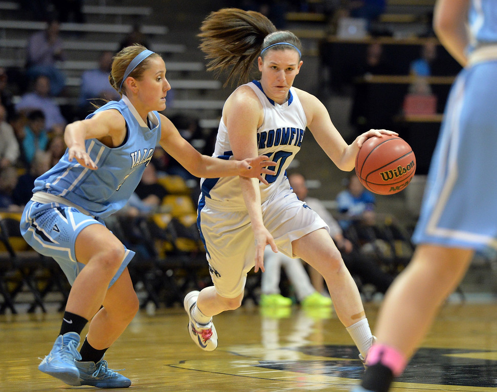 . Broomfield\'sBri Wilbur dribbles the ball past Valor Christian\'s Meagan Foley during the final four 4A state game at Coors Event Center. (David R. Jennings/Broomfield Enterprise)