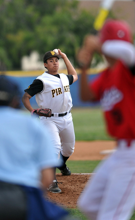 . 4/6/13 - Nacio Zuniga pitching for San Pedro High School against Arleta High School on Saturday morning at Harbor City College in a non-league game. Photo by Brittany Murray / Staff Photographer