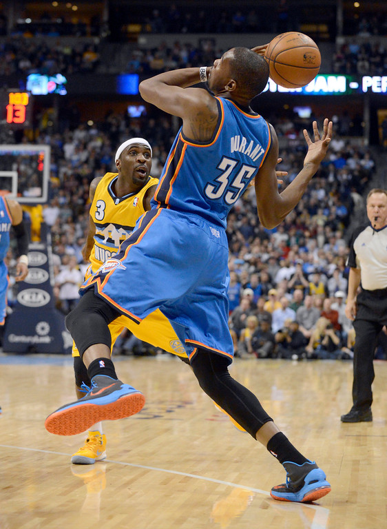 . DENVER, CO. - JANUARY 20: Denver Nuggets point guard Ty Lawson (3) knocks the ball the hands of Oklahoma City Thunder small forward Kevin Durant (35) during an inbound pass late in the fourth quarter January 20,  2013 at Pepsi Center. The Denver Nuggets defeated the Oklahoma City Thunder 121-118.  (Photo By John Leyba / The Denver Post)