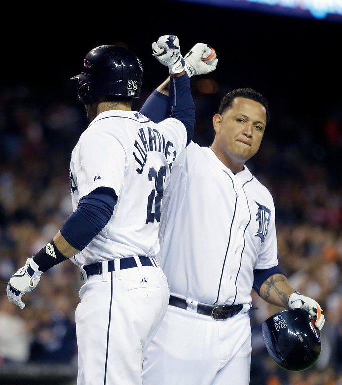 . Detroit Tigers\' J.D. Martinez is congratulated by teammate Miguel Cabrera after they both scored on Martinez\'s two-run home run during the fourth inning of a baseball game against the Cleveland Indians in Detroit, Friday, Sept. 12, 2014. (AP Photo/Carlos Osorio)