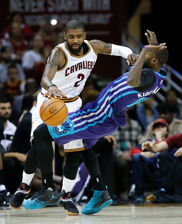 . Cleveland Cavaliers\' Kyrie Irving (2) drives on Charlotte Hornets\' Michael Kidd-Gilchrist (14) during the second half of an NBA basketball game Sunday, Nov. 13, 2016, in Cleveland. The Cavaliers won 100-93. (AP Photo/Ron Schwane)