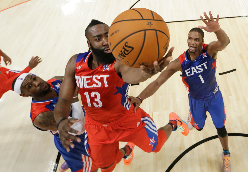 . West Team\'s James Harden of the Houston Rockets shoots as East Team\'s LeBron James, left, and Chris Bosh of the Miami Heat defend during the second half of the NBA All-Star basketball game Sunday, Feb. 17, 2013, in Houston. (AP Photo/Eric Gay)