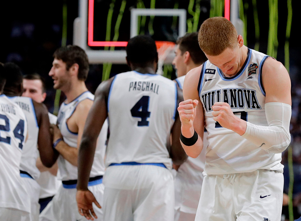 . Villanova players celebrate after the championship game of the Final Four NCAA college basketball tournament against Michigan, Monday, April 2, 2018, in San Antonio. Villanova won 79-62. (AP Photo/David J. Phillip)