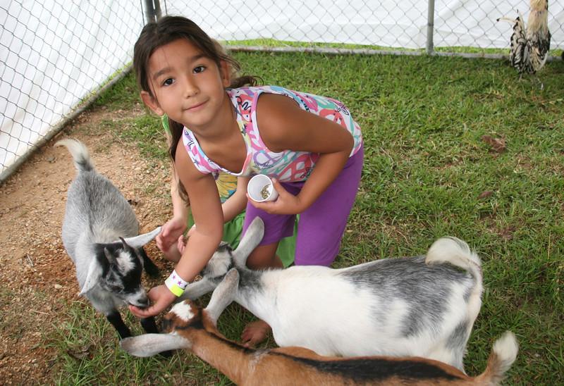 Rosa Garcia feeds goats @ Petting Zoo