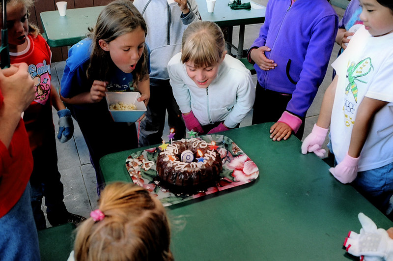 Elena apparently getting help with her birthday candles, Spet. 2005.