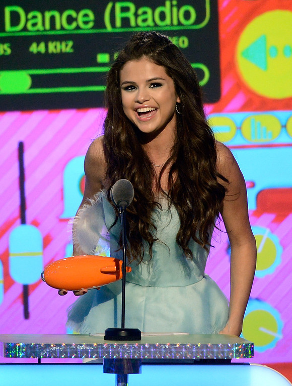 ". LOS ANGELES, CA - MARCH 23:  Actress Selena Gomez, winner of Favorite Television Actress for ""Wizards of Waverly Place,\"" speaks onstage during Nickelodeon\'s 26th Annual Kids\' Choice Awards at USC Galen Center on March 23, 2013 in Los Angeles, California.  (Photo by Kevork Djansezian/Getty Images for KCA)"