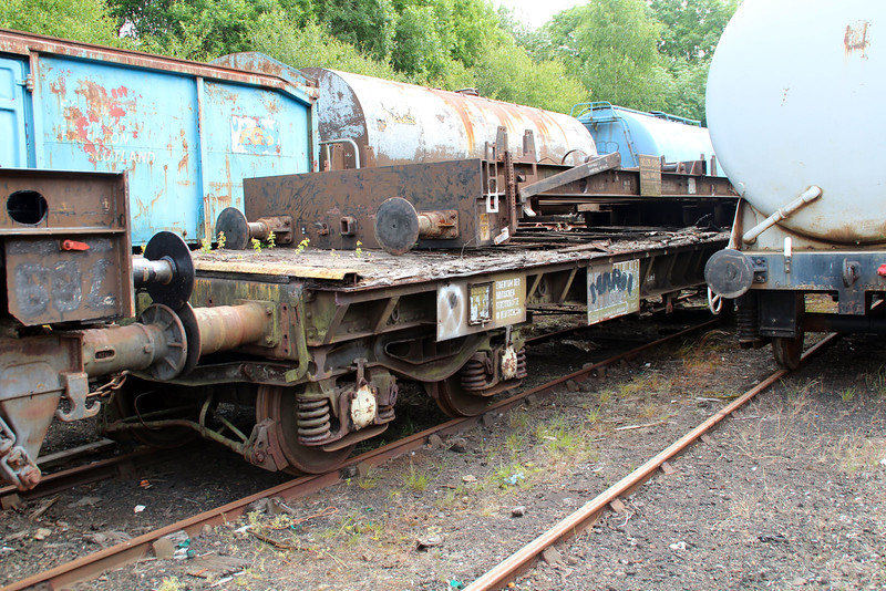 RIV 33804733066-1 with PFA DRSL 92736 upside down on top and bogie less, outside E.G.Steele's workshops 20/06/13.