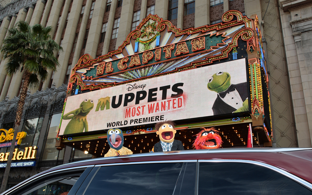 """. (L-R) Muppets The Great Gonzo, Walter and Animal arrive for the premiere of Disney\'s \""""Muppets Most Wanted\"""" at the El Capitan Theatre on March 11, 2014 in Hollywood, California.  (Photo by Kevin Winter/Getty Images)"""