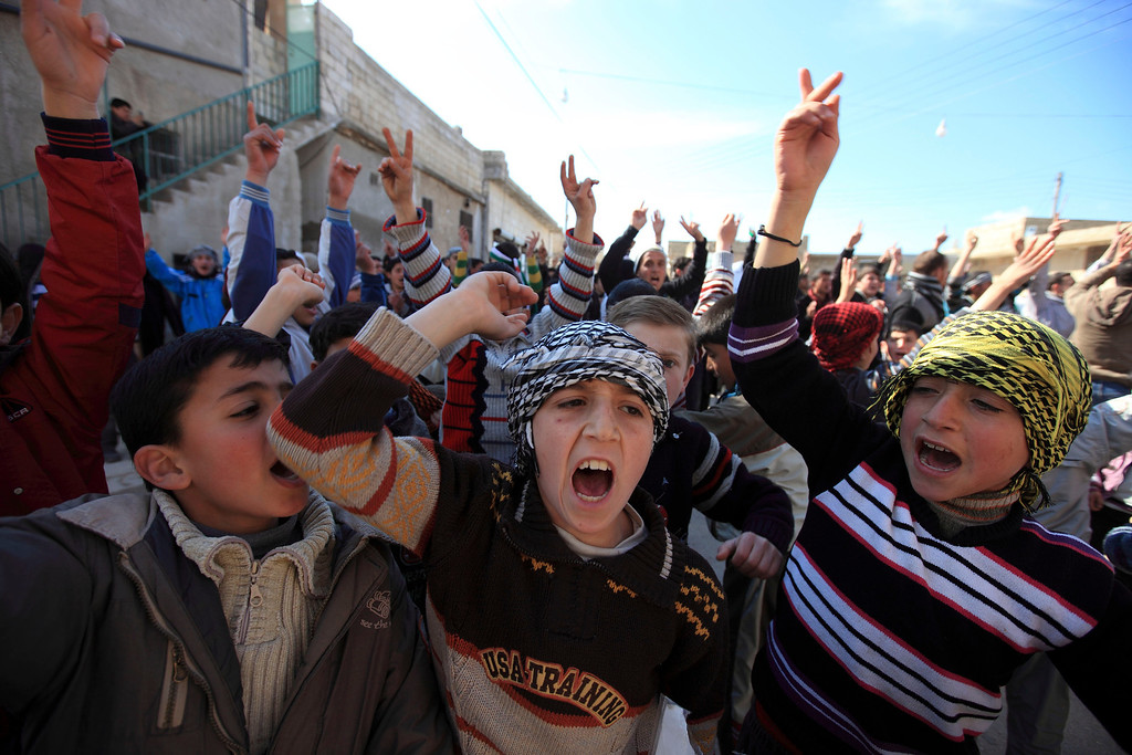 . Children chant slogans during a demonstration against Syria\'s President Bashar al-Assad in in Hazzano, Idlib province March 2, 2012.  REUTERS/Zohra Bensemra