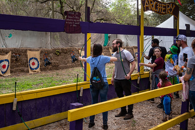 Visitors Practicing their Archery Skills