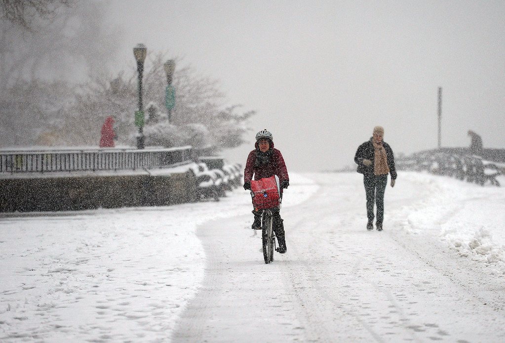 . People make their way as a snow storm hits New York, March 8, 2013.  AFP PHOTO/EMMANUEL  DUNAND/AFP/Getty Images
