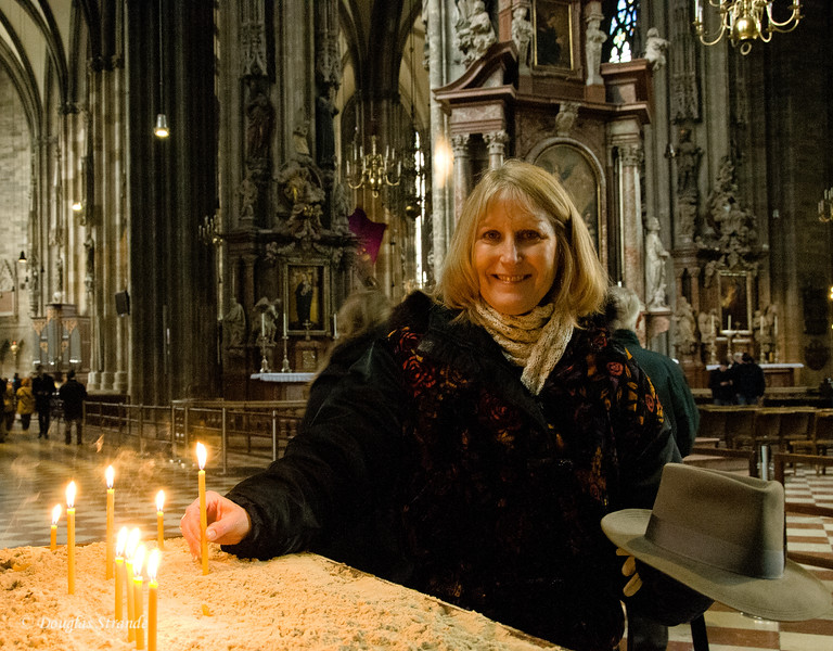 June lighting a candle in St. Stephen's Cathedral in Vienna