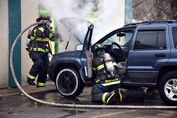 3/1/2019 Mike Orazzi | Staff Bristol firefighters extinguish a Jeep that caught fire on Riverside Avenue in Bristol Friday. No injuries were reported and more information was available.