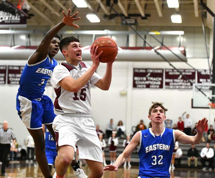1/24/2020 Mike Orazzi | Staff Bristol Central High School's Shane Ouellette (15) and Bristol Eastern's Elijah Borgelin (3) during Friday night's boys basketball game at Central.