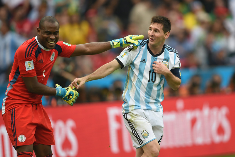 . Argentina\'s forward Lionel Messi (R) and Nigeria\'s goalkeeper Vincent Enyeama smile during a Group F football match between Nigeria and Argentina at the Beira-Rio Stadium in Porto Alegre during the 2014 FIFA World Cup on June 25, 2014. (PEDRO UGARTE/AFP/Getty Images)