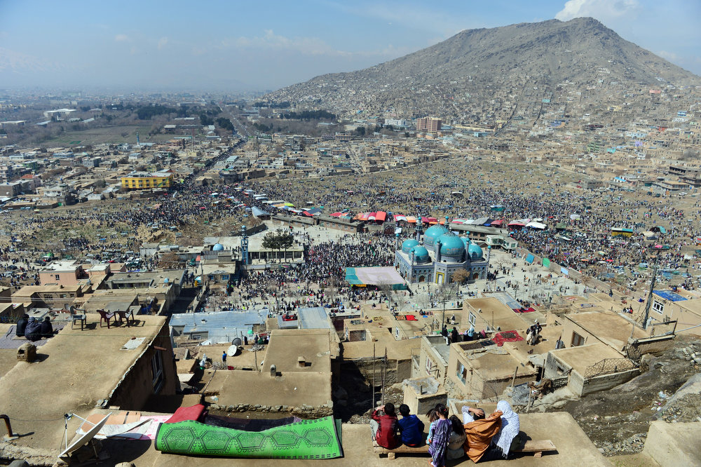 . Afghan families gather on top of their home\'s roof near Sakhi shrine, the centre of the Afghanistan new year celebrations in Kabul during Nowruz festivities on March 21, 2013. Nowruz, one of the biggest festivals of the war-scarred nation, marks the first day of spring and the beginning of the year in the Persian calendar. Nowruz is calculated according to a solar calendar, this coming year marking 1392. MASSOUD HOSSAINI/AFP/Getty Images