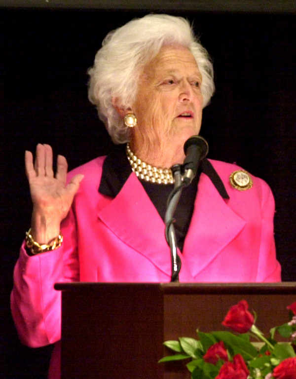 . Former first lady Barbara Bush entertains an audience in Omaha, Neb., with stories of her family, during a Red Cross dinner Tuesday, Oct. 23, 2001. Bush told the Omaha audience that we must fight this war against evil not only with force, but with generosity, love and friendship. (AP Photo/Nati Harnik)