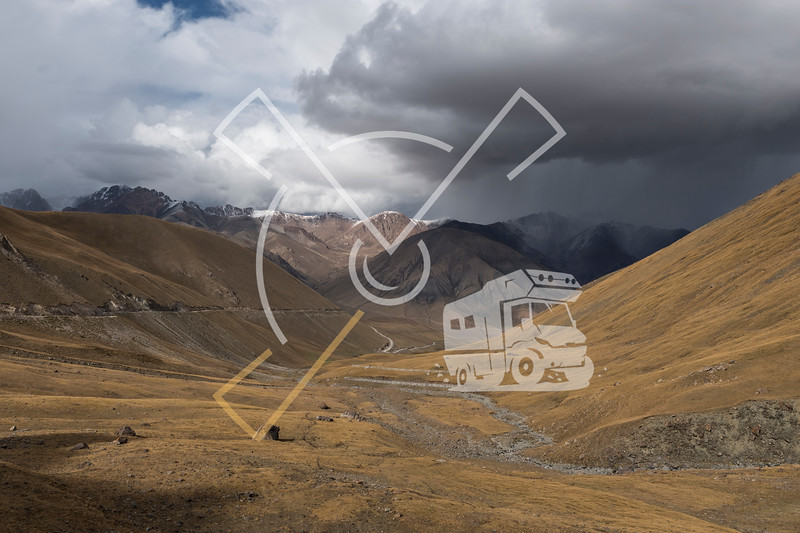 Scenic landscape panorama of the first autumn snow and rainfall over the Kyrgyz Pereval Kalmak-Ashu pass