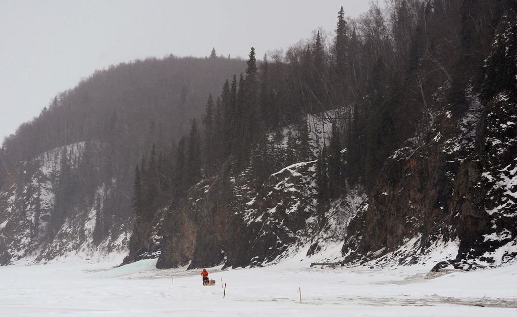 . Musher Jake Berkowitz drives his dog team up the Yukon River after leaving the checkpoint in Anvik, Alaska, on Friday, March 8, 2013, during the Iditarod Trail Sled Dog Race. (AP Photo/Anchorage Daily News, Bill Roth)