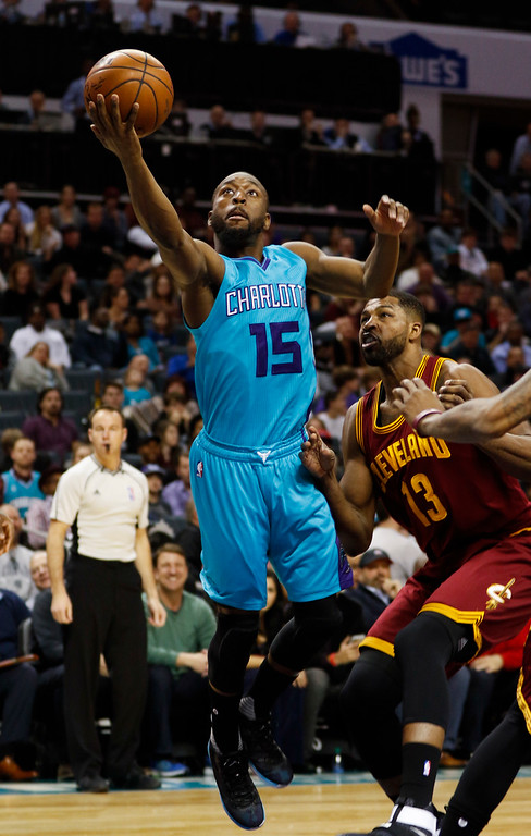 . Charlotte Hornets guard Kemba Walker, left, drives to the basket past Cleveland Cavaliers center Tristan Thompson during the first half of an NBA basketball game in Charlotte, N.C., Saturday, Dec. 31, 2016. (AP Photo/Nell Redmond)