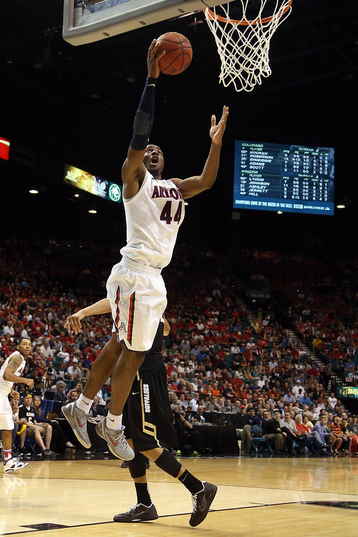 . Solomon Hill #44 of the Arizona Wildcats lays the ball up in the second half against the Colorado Buffaloes during the quarterfinals of the Pac-12 tournament at the MGM Grand Garden Arena on March 14, 2013 in Las Vegas, Nevada.  (Photo by Jeff Gross/Getty Images)